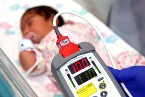 Picture showing baby having pulse oximetry test at Royal Berkshire Hospital